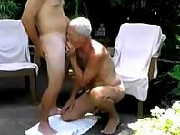 Fit Older gay Men kissing and tonguing with a bisex amateur in toilets.